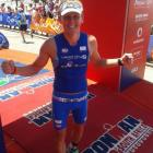 Kyle Buckingham at the finish at SA70.3